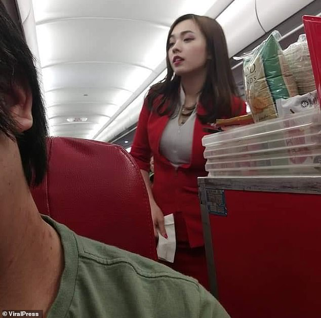 Mabel Goo, a 24-year-old Chinese flight attendant living in Malaysia, was working on an AirAsia flight from Hong Kong on October 12th, when passenger George Wong took the snap above - which Mabel has since shared to her Instagram followers