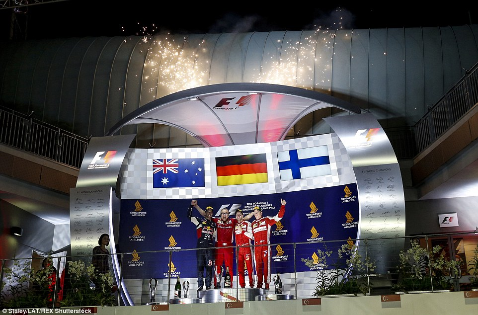 Ricciardo, Vettel and Raikkonen celebrate on the podium in front of the Singapore fans following their drives at the Marina Bay Circiut