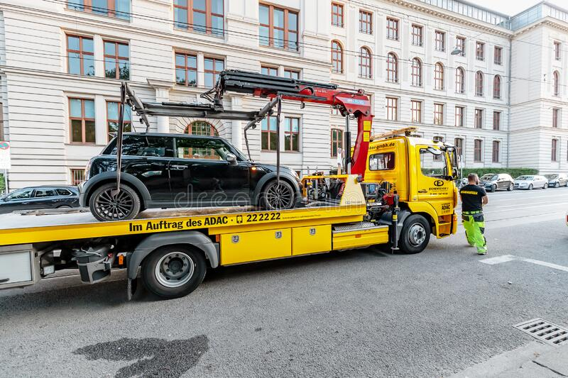 Tow truck takes the car for wrong Parking in the city street royalty free stock photos