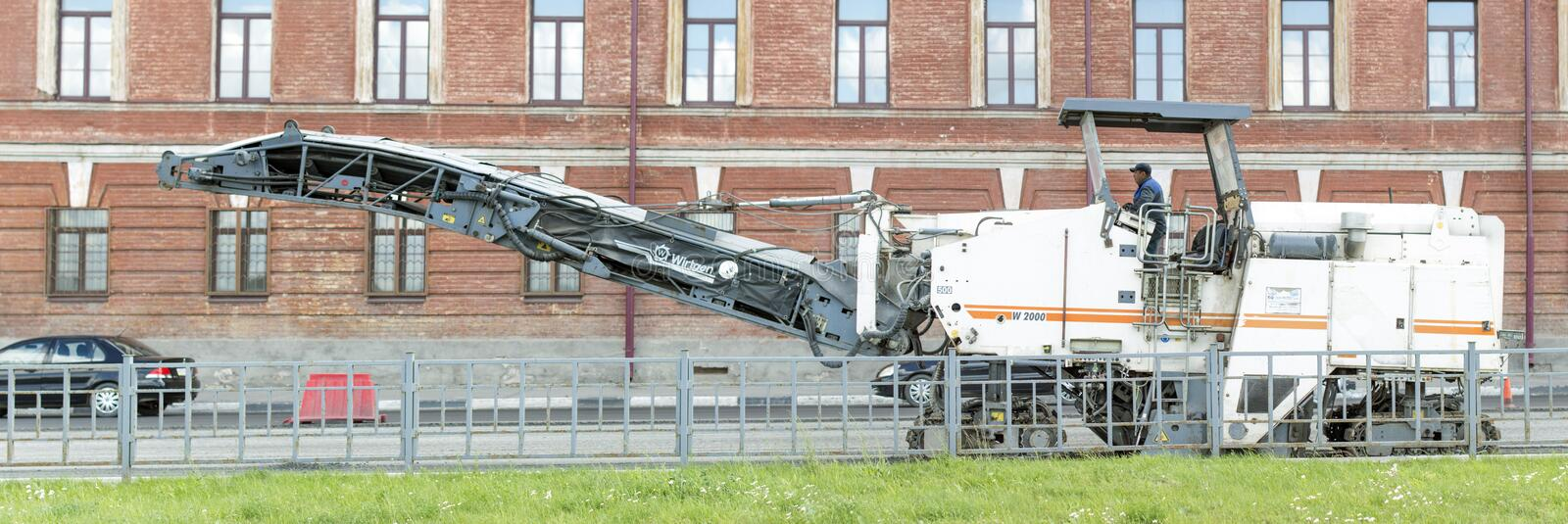 Auto appliances communal services of the city. The Auto appliances for collecting old asphalt and loading into the truck kamaz. NIZHNY NOVGOROD, RUSSIA June 28 stock photo