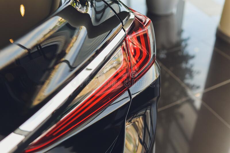 Back view of new black car. Closeup headlights of car. Black premium city crossover, luxury SUV rear light closeup. Car. Lamp close-up stock image