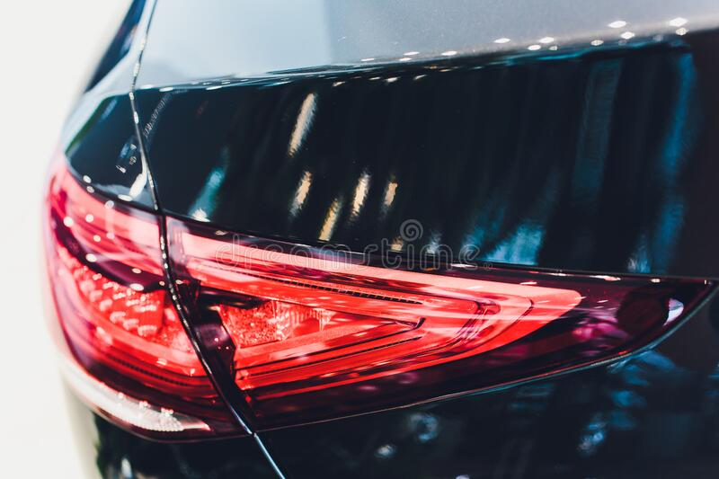Back view of new black car. Closeup headlights of car. Black premium city crossover, luxury SUV rear light closeup. Car. Lamp close-up royalty free stock photography