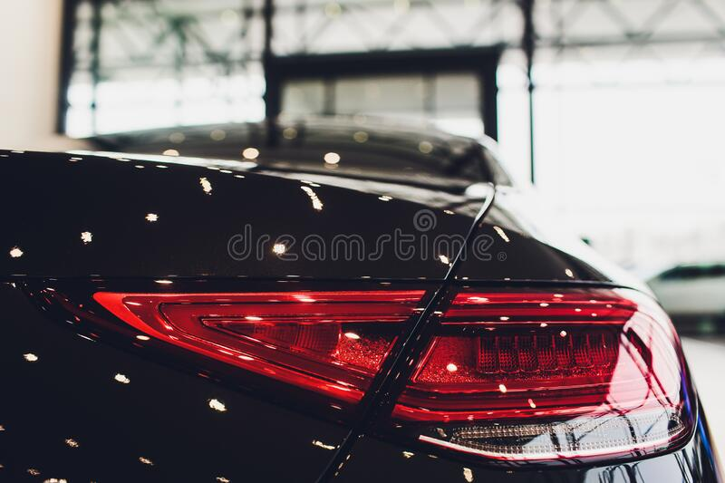 Back view of new black car. Closeup headlights of car. Black premium city crossover, luxury SUV rear light closeup. Car. Lamp close-up royalty free stock photo