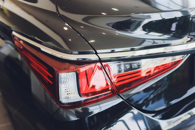 Back view of new black car. Closeup headlights of car. Black premium city crossover, luxury SUV rear light closeup. Car. Lamp close-up stock photography