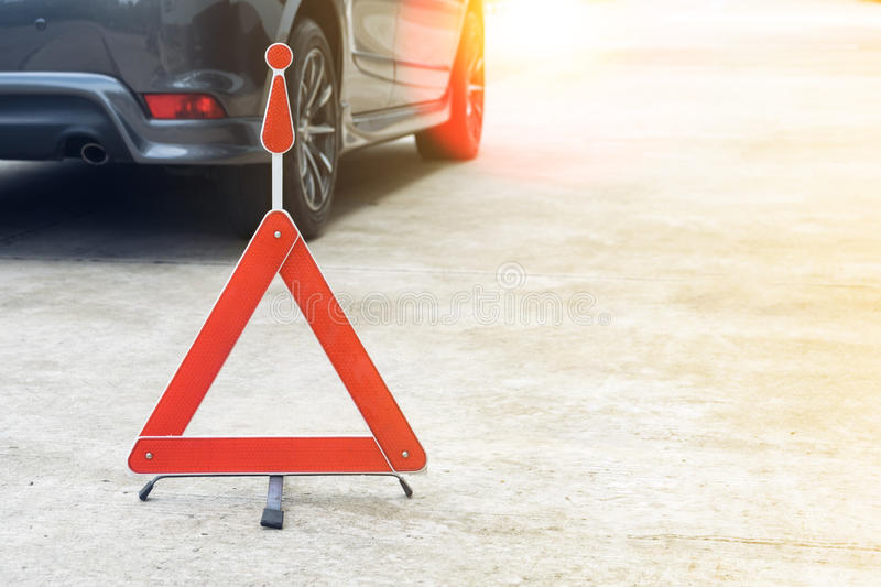 Broken car sign on a road. With a broken down car stock photography