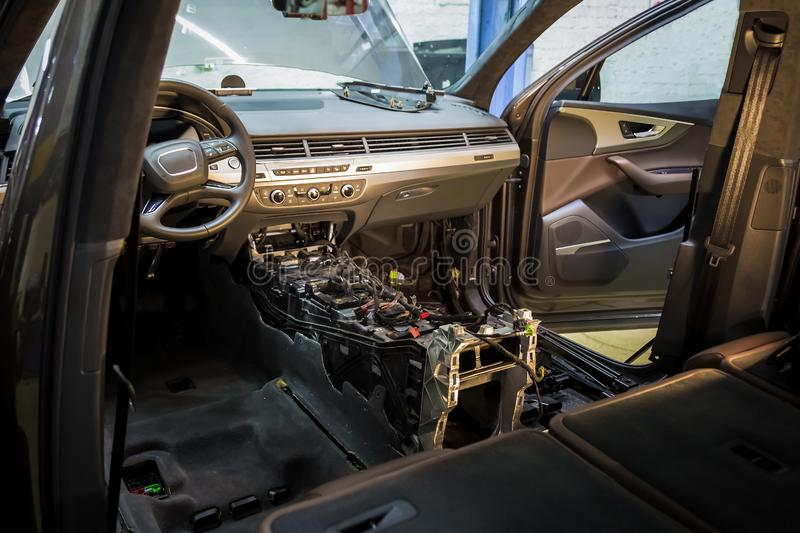 Car repair service center. Dismantled car interior. Check car wiring. Removed chairs, floor trim. leather interior premium. Crossover. Gearbox repair royalty free stock images