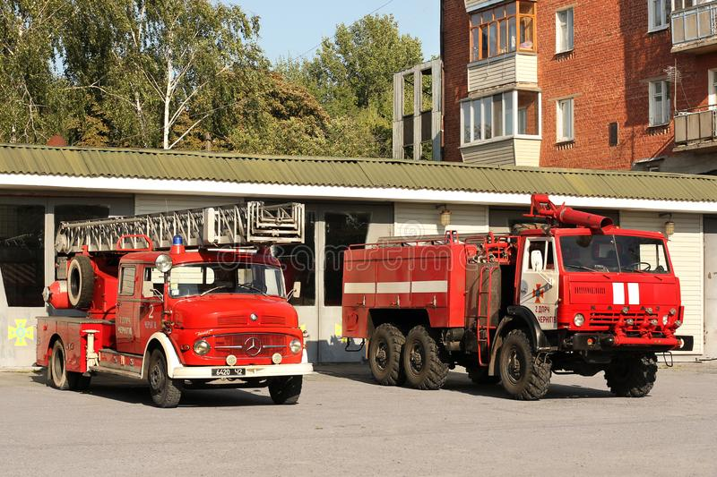 Chernihiv, Ukraine: July 31, 2019: Old fire truck. Big red Mercedes. Two fire trucks. Red Kamaz. Old fire truck. Big red Mercedes. Two fire trucks. Red Kamaz stock images