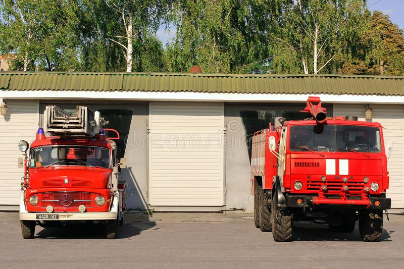 Chernihiv, Ukraine: July 31, 2019: Old fire truck. Big red Mercedes. Two fire trucks. Red Kamaz. Old fire truck. Big red Mercedes. Two fire trucks. Red Kamaz royalty free stock image