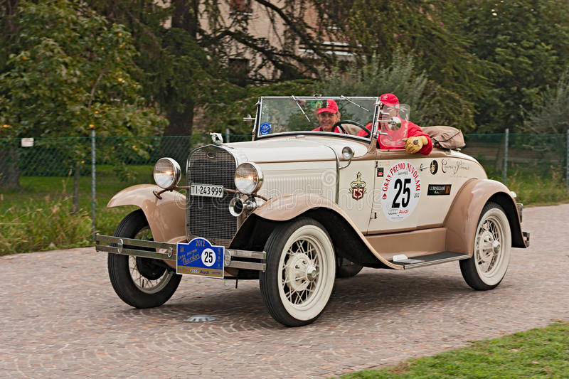 Classic car Ford. An old car Ford A Roadster Deluxe (1951) runs in rally Gran Premio Nuvolari 2012, endurance race for classic cars, on September 23, 2012 in stock image