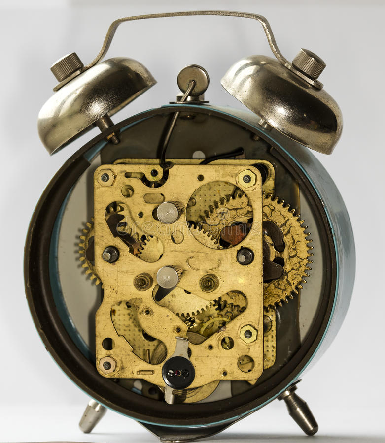 Clockwork vintage alarm clock. Clockwork old mechanical USSR alarm clock royalty free stock images