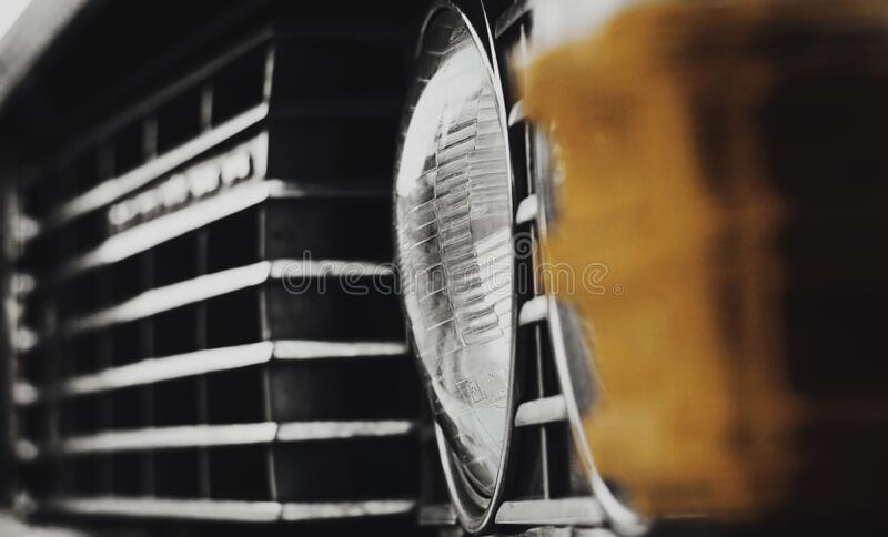 Close-Up Classic Vintage Car Front Grill and Headlight detail. Photo of Retro Car Headlight. USSR Car Industry. . High Quality. Photo stock photo