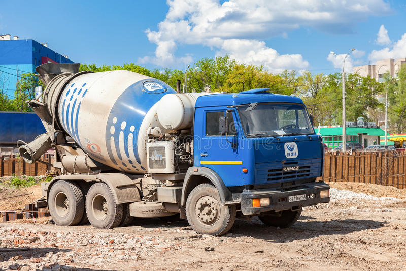 Concrete mixer truck KAMAZ at the construction of road. SAMARA, RUSSIA - MAY 7, 2016: Concrete mixer truck KAMAZ at the construction of road royalty free stock photography