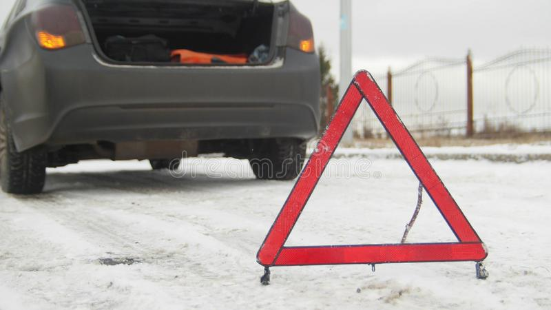 An emergency sign set after the broken car on the road. Close up royalty free stock photography