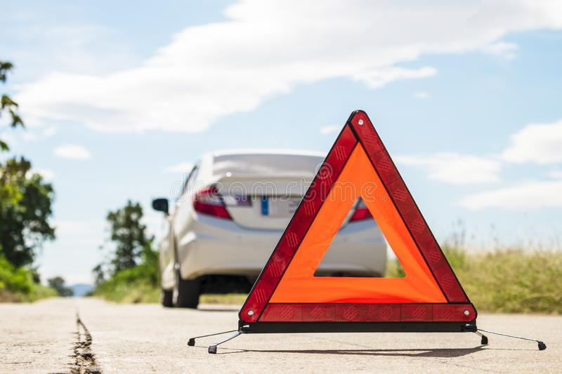 Emergency stop sign and broken car on road. Beware ,Warning sign ,Please be careful ,Road ,Broken car royalty free stock images