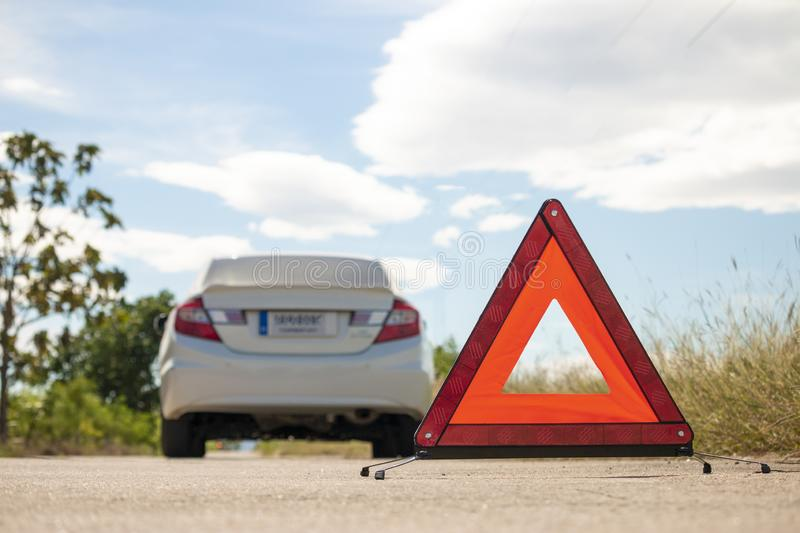 Emergency stop sign and broken car on road. Warning sign ,Beware stock images