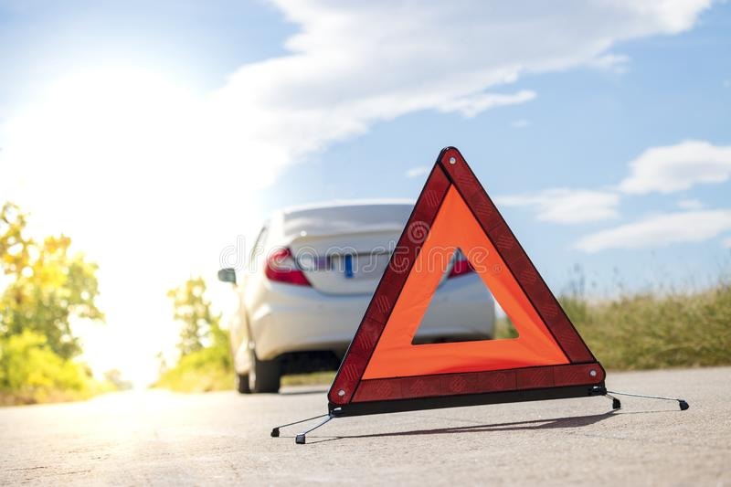 Emergency stop sign near broken car on road. Emergency stop sign near broken car on road stock photos