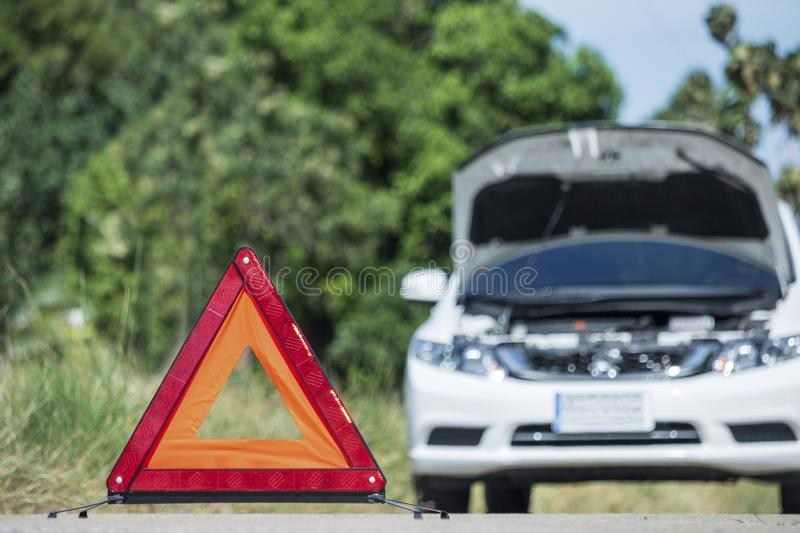 Emergency stop sign near broken car on road. Emergency stop sign near broken car on road royalty free stock photos