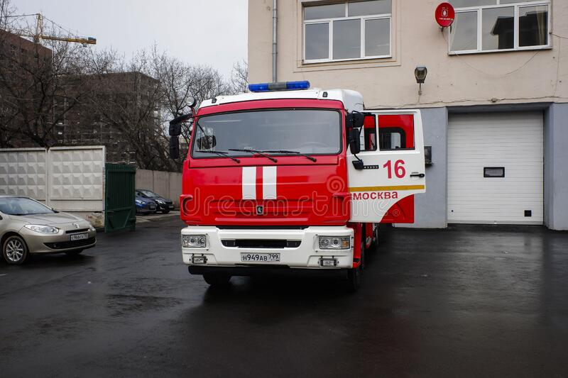 Fire fighting vehicle KAMAZ in front of the fire station close to Aviamotornaya underground station in Moscow, Russia.. Fire fighting vehicle KAMAZ in front of royalty free stock images