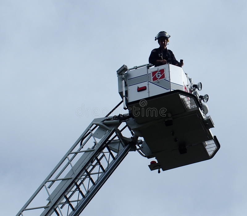 Firemen In Ladder Truck royalty free stock photos
