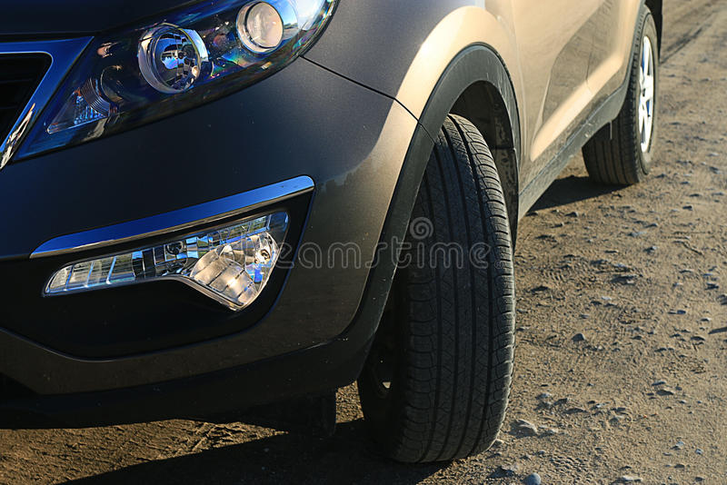 Fragment of the crossover car on the road. Fragment of the crossover SUV car on the road stock photo
