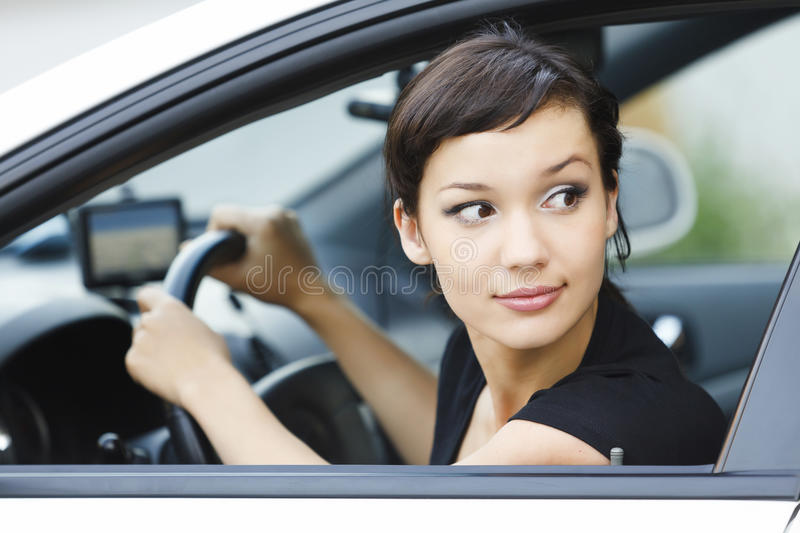 Girl parking a car. Young pretty girl parking a car royalty free stock photos