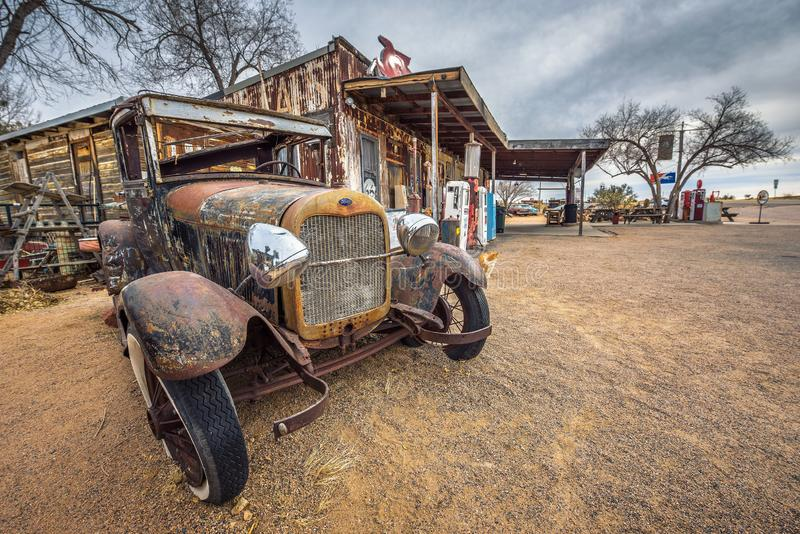 Old Ford car abandoned on route 66 in Arizona. Hackberry, Arizona, USA - January 2, 2018 : Old and rusty Ford car abandoned near the Hackberry General Store stock photos