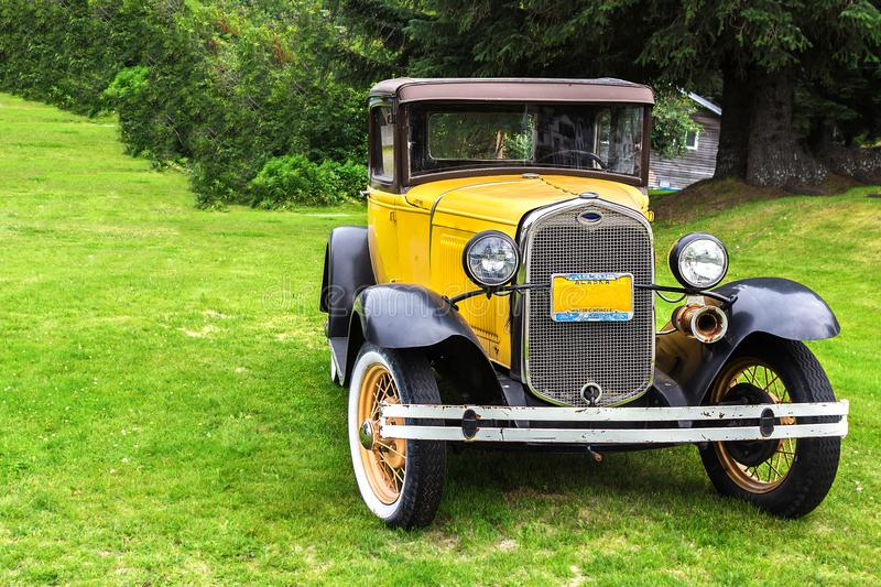 A Ford car model 1930 in Haines, Alaska. Haines, Alaska, USA - July 29th, 2017: A vintage Ford car model 1930 in Fort Seward, Haines, Alaska stock image