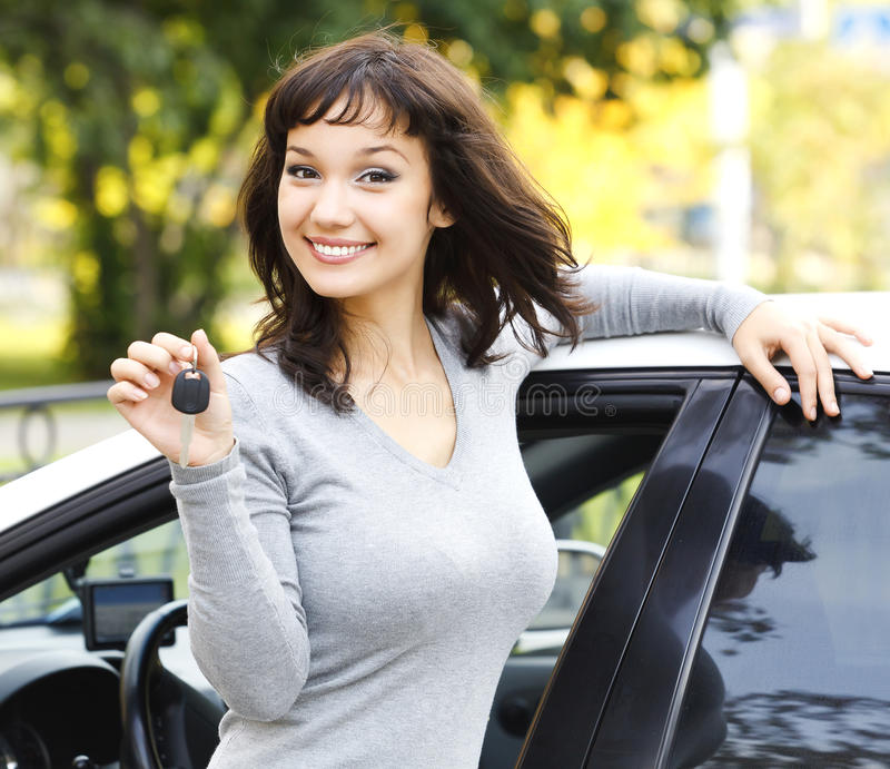 Happy girl with car key. Happy girl showing the car key stock images