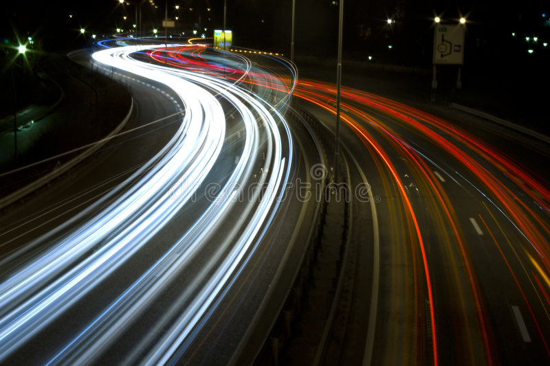 Highway at night by harbour 3 stock image