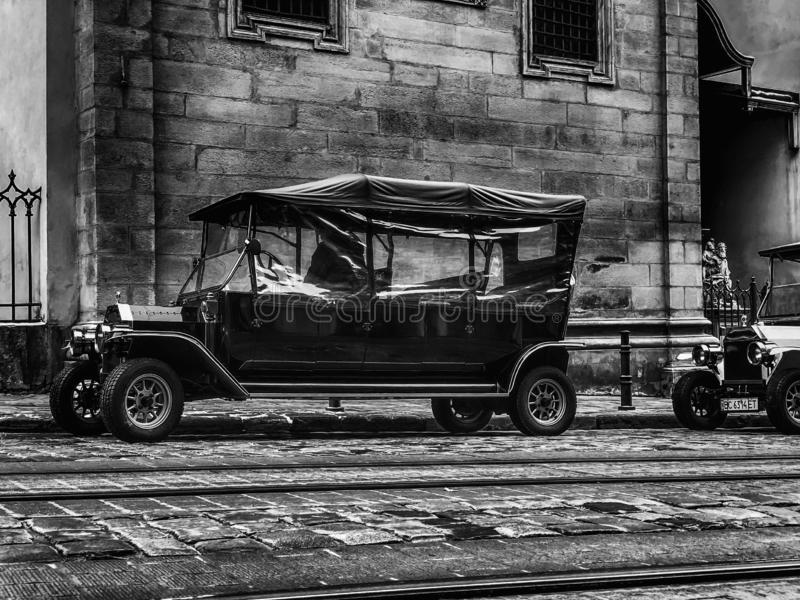 LVIV, UKRAINE - NOVEMBER 20, 2018: Old retro car Ford T its owner and an unknown passenger. Ukraine. LVIV, UKRAINE - NOVEMBER 20, 2018: Old retro car Ford T its royalty free stock photography