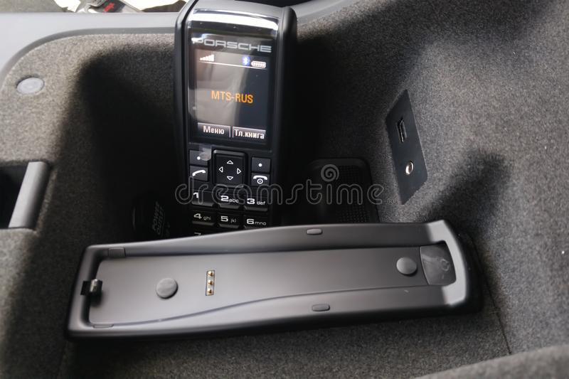 Moscow. February 2019. Porsche handset in the interior of the premium Porsche Cayenne crossover. Phone receiver in armrest of a. Car stock images