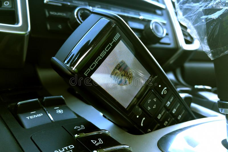 Moscow. February 2019. Porsche handset in the interior of the premium Porsche Cayenne crossover. Phone receiver in car.  royalty free stock photography