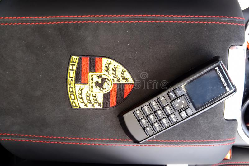 Moscow. February 2019. Porsche handset in the interior of the premium Porsche Cayenne crossover. Phone receiver in car on armrest. With red stitching stock photo
