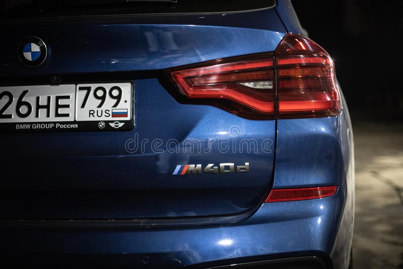 Moscow. Russia - December 06, 2019: The all-new BMW X3. Blue crossover stands on the street at night. Premium German SUV. Back. Side and taillights M40d engine royalty free stock image