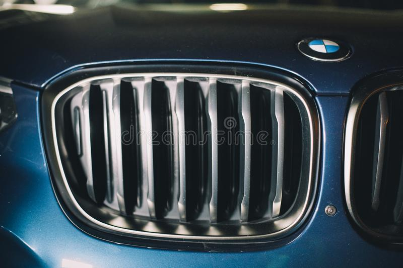 Moscow. Russia - December 06, 2019: The all-new BMW X3. Blue crossover stands on the street at night. Premium German SUV. front. Grill of premium car stock image
