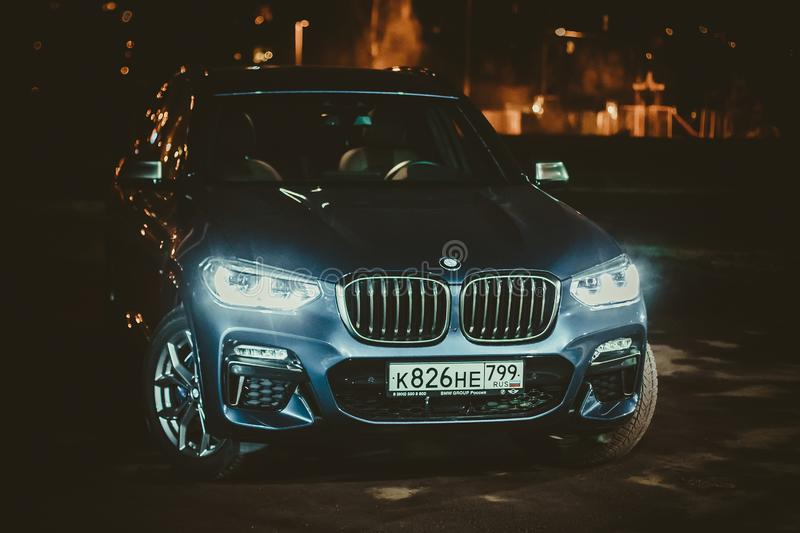 Moscow. Russia - December 06, 2019: The all-new BMW X3. Blue crossover stands on the street at night. Premium German SUV front. View royalty free stock photo