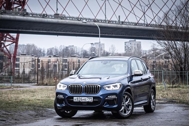 Moscow. Russia - December 06, 2019: The all-new BMW X3. Blue crossover stands on the street at night. Premium German SUV. front. View stock photography