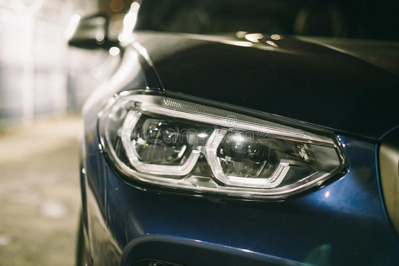 Moscow. Russia - December 06, 2019: The all-new BMW X3. Blue crossover stands on the street at night. Premium German SUV. light. Alloy wheels. LED headlight royalty free stock photos