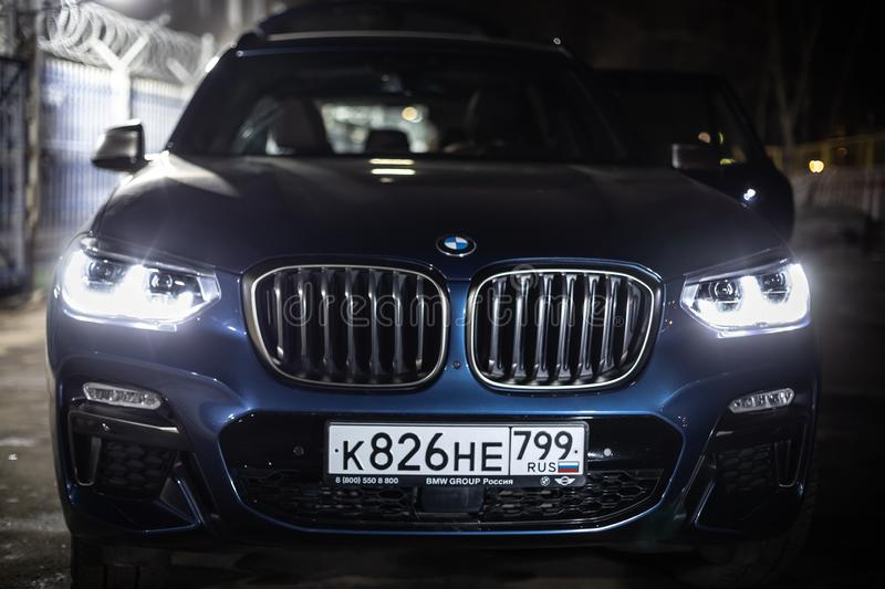 Moscow. Russia - December 06, 2019: The all-new BMW X3. Blue crossover stands on the street at night. Premium German SUV. Parked. Moscow. Russia - December 06 stock photo