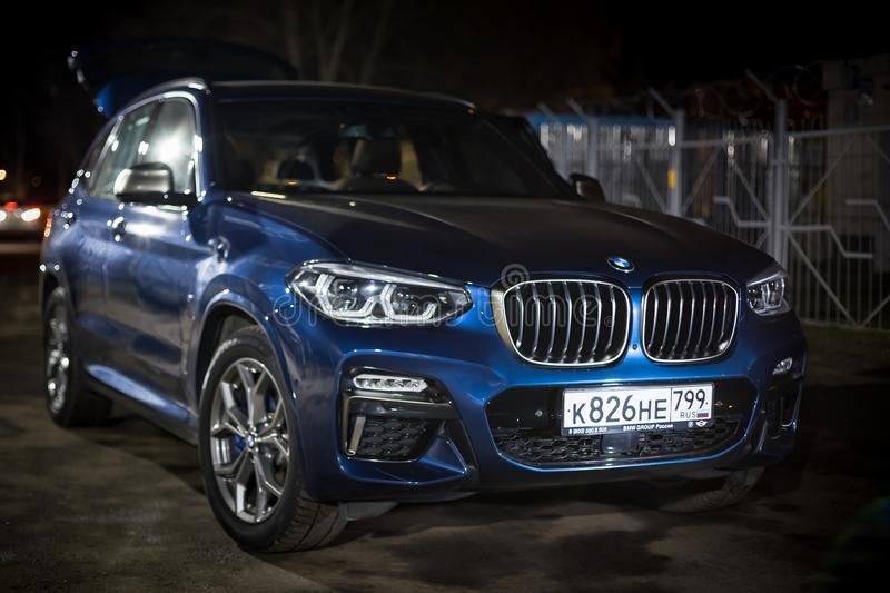 Moscow. Russia - December 06, 2019: The all-new BMW X3. Blue crossover stands on the street at night. Premium German SUV. Parked.  royalty free stock photos