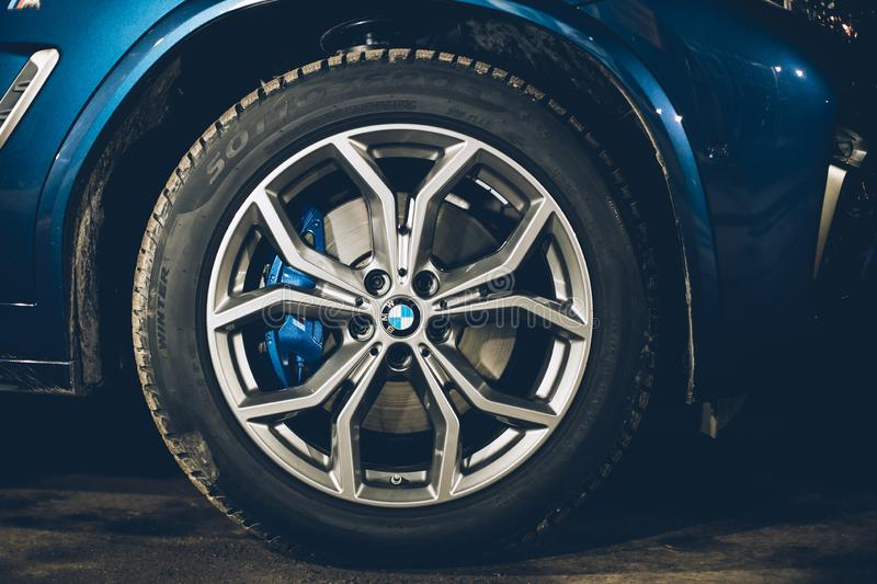 Moscow. Russia - December 06, 2019: The all-new BMW X3. Blue crossover stands on the street at night. Premium German SUV. Wheel. Close up, light alloy wheels stock photos