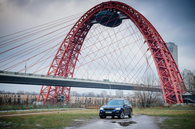 Moscow. Russia - December 06, 2019: The all-new BMW X3. Blue crossover stands on the street at night. Premium German SUV. and. Moscow. Russia - December 06, 2019 royalty free stock photos
