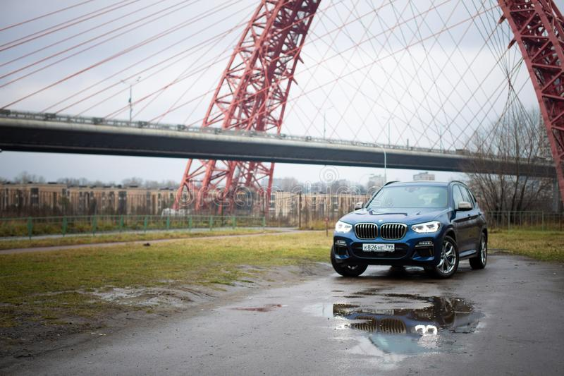 Moscow. Russia - December 06, 2019: The all-new BMW X3. Blue crossover stands on the street at night. Premium German SUV. front. Moscow. Russia - December 06 royalty free stock photo