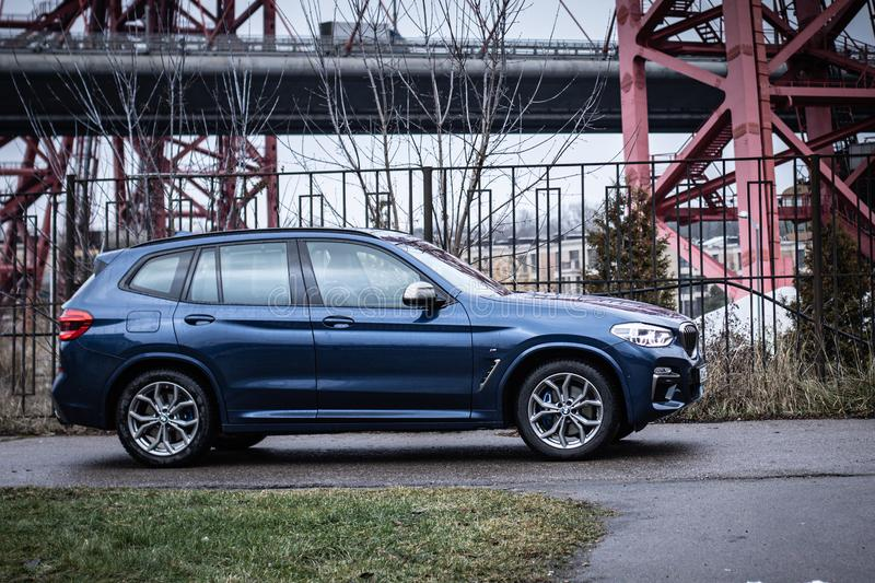 Moscow. Russia - December 06, 2019: The all-new BMW X3. Blue crossover stands on the street at night. Premium German SUV. Side. Moscow. Russia - December 06 stock photo
