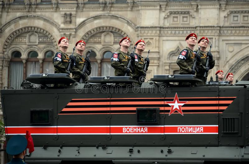 Soldiers of military police on an armored truck KamAZ-63968 `Typhoon-K` during the rehearsal of the Victory Parade. MOSCOW, RUSSIA MAY 6, 2018: Soldiers of the stock photography