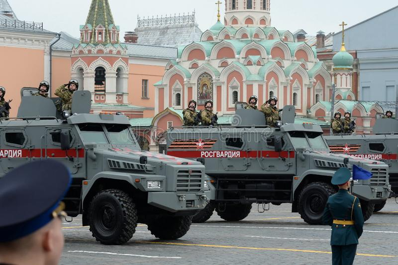 Soldiers of the national on the multi-purpose armored car `Typhoon-K` on the basis of KAMAZ - 53949. MOSCOW, RUSSIA - MAY 9, 2019: Soldiers of the national guard royalty free stock photos