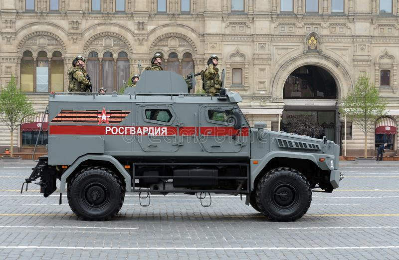 Soldiers of the national on the multi-purpose armored car `Typhoon-K` on the basis of KAMAZ - 53949. MOSCOW, RUSSIA - MAY 9, 2019: Soldiers of the national guard stock images