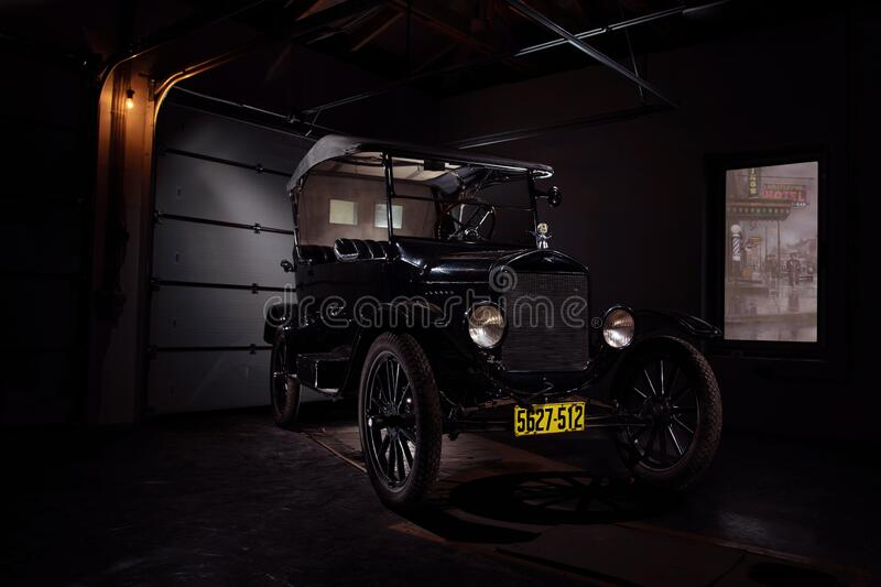 Classic old Ford Model T black color car with leather roof in garage exterior photo. Moscow Russia November 2 2019: Classic old Ford Model T black color car with royalty free stock photography
