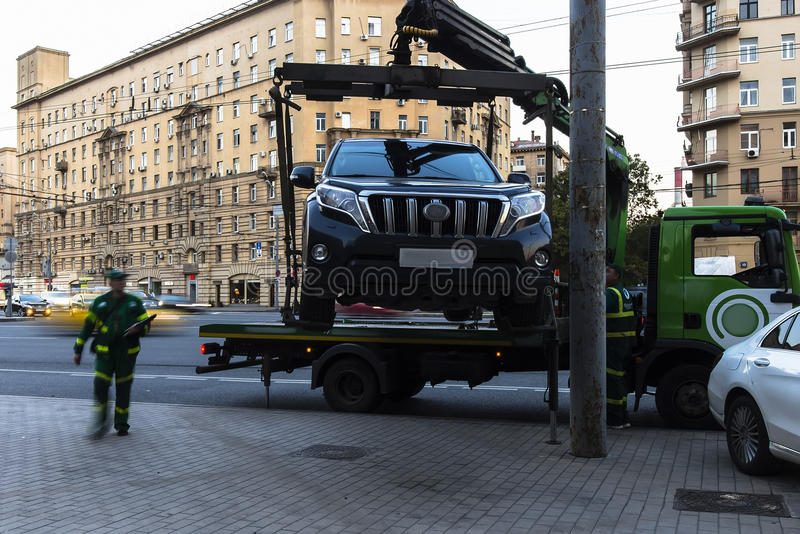 Moscow;Russia,September -first-Two thousand sixteen year;working of  tow truck  ,car evacuation for parking violation royalty free stock photography