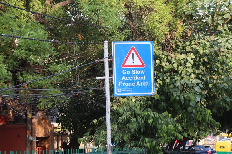 `New Delhi/India-21/06.2020:  Street  Signs  Diection  GoSlow Accident prone Area with Green Background` royalty free stock photos